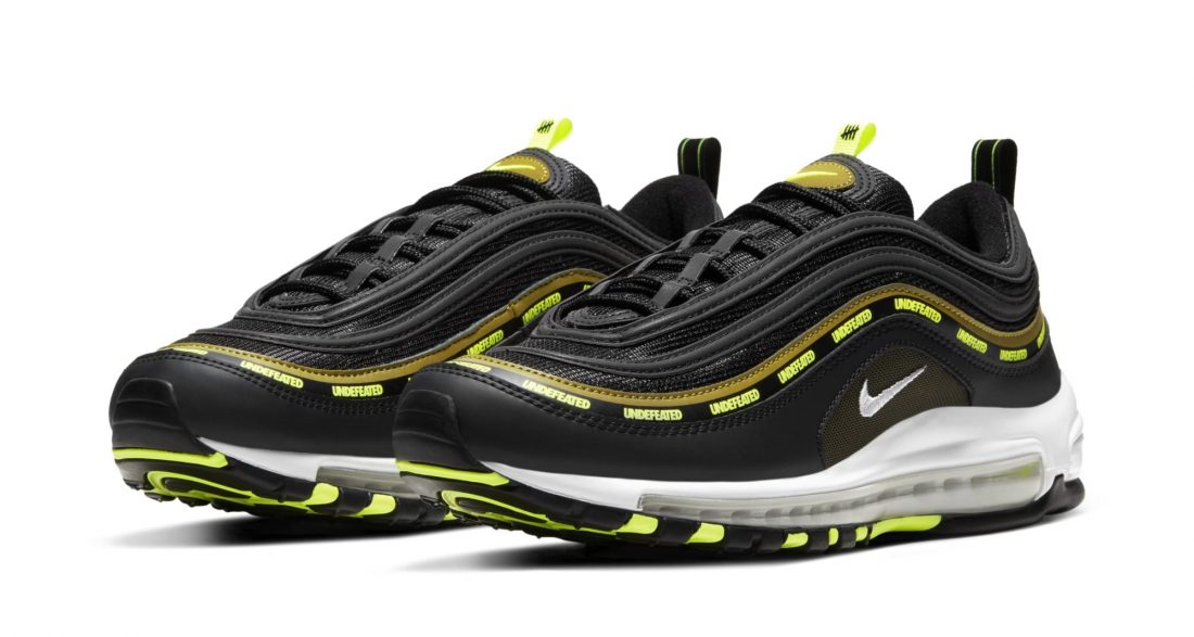 """UNDEFEATED x Nike Air Max 97 """"Black Volt""""."""